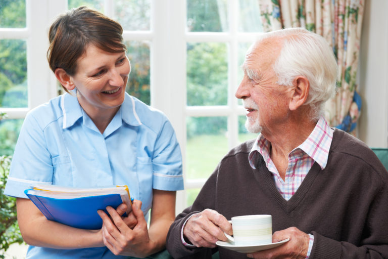Senior man With domiciliary care At Home